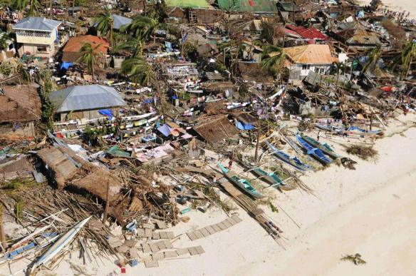 An aerial view of a coastal village in Concepcion, Iloilo after Yolanda. (Photo  credits: Iloilo Provincial Administrator, Dr. Raul Banias/AFP, shared through rappler.com)