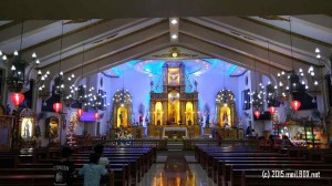 The altar and center aisle of the Most Holy Redeemer Parish-St Philomena Shrine, taken after today's Simbang Gabi. [Image by M. Velas-Suarin]