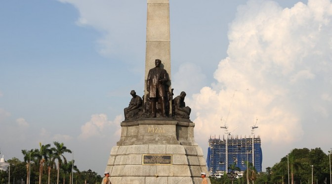 The Jose Rizal Monument – sharing the line of sight with Torre de Manila [Image taken by this author in September 2014. The Torre de Manila is now significantly taller than this.]